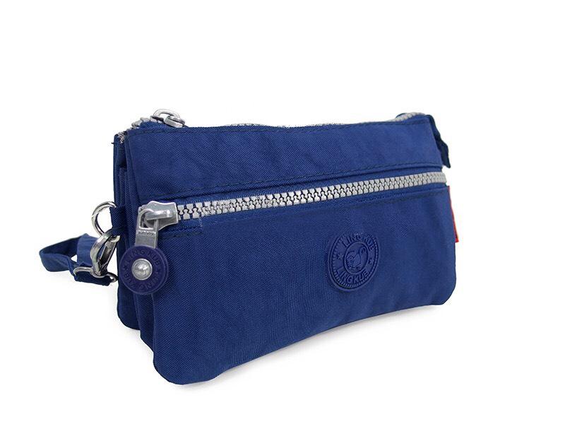 กระเป๋าคล้องมือ ผ้าเนื้อ Kipling สีน้ำเงิน
